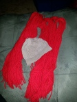 Image of yarn groupings and pantyhose cap for Raggedy Ann.