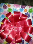 Lay ribbon folds in circle, glue together and glue white foam board circle in center.