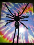 Get a rubber spider from dollar store, add black pipe cleaner to make a spider tie.