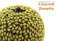 Beaded pumpkins can be pretty or scary. It's as simple as using straight pins, beads and your imagination. Image courtesy of Handmadehappyhour.com.