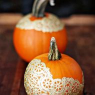 Doily pumpkin magic: White doilies glued on pumpkins can work well for weddings. Black doilies - can make it more Victorian. Image courtesy of Domainehome.com
