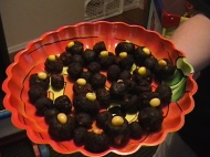 DOO DOO BALLS WITH CORN: After making a batch of brownies in a pan, scoop out approx. a tsp. of brownie and roll into a ball. Stick in whole or halves of candy corn into each ball to give the appearance of undigested corn in poop. Image and recipe courtesy of Debbie Morrow. All Rights Reserved.