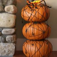 String your pumpkin: It can be as easy as making a web and adding a plastic spider or take it further and wrap colored string, twine, or rope around the entire outside. Image courtesy of J Palmisano at diynetwork.com
