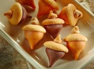A chocolate kiss, nilla wafer, and a chip can create these acorn cookies. Image and recipe can be found at:https://www.hersheys.com/recipes/recipe-details.aspx?id=8805