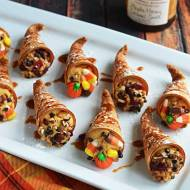 Sugar cone cornucopias can be filled with pretty much anything - candy, trail mix, mini crackers, etc. For this image, Host the Toast has filled them with pumpkin cream cheese. The directions can be found at: http://www.thrillist.com/eat/nation/cornucopia-cannoli-recipe-by-host-the-toast