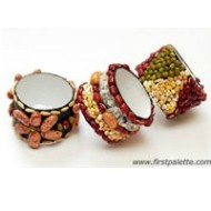 Using seeds to cover your napkin rings is a perfect way to create an image of a bountiful harvest. Image courtesy of First Palette and the tutorial can be found at: http://www.freekidscrafts.com/seed-napkin-rings/