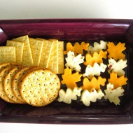 Leaf cookie cutters help make this fall cheese and crackers tray pop! Image courtesy of blog.dollhousebakeshoppe.com