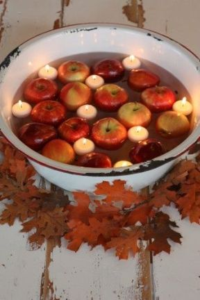 Old basins are easy to find and the worn, chipped edges only adds to the nostalgic charm of floating apples and candles. Toss a few silk leaves around and it can't get much easier. Image courtesy of New Ideas for You.