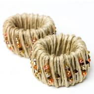 Twine and fall-colored beads make these rings perfect for the season. Image courtesy of Prima Bead with the tutorial at; http://www.primabead.com/Fall-Harvest-Napkin-Rings-Set-of-4-P8920.aspx?custom_ref=x402sP