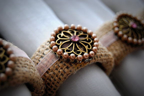 Burlap makes a great fabric base to embellishments for Fall napkin rings.  Image courtesy of Tater Tots and Jello, where they offer a tutorial at; http://tatertotsandjello.com/2010/02/burlap-napkin-rings-tutorial-dollar.html