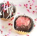 Tidymom.net offers a strawberry cake ball recipe covered with melted chocolate.