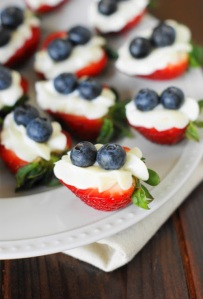 Easy red, white, and blue Cheesecake-Stuffed Strawberries. Image/detailed directions at: thekitchenismyplayground.com